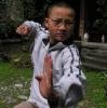 我们的功夫老师叫puma,才14岁,可是还是不算比较小的和尚